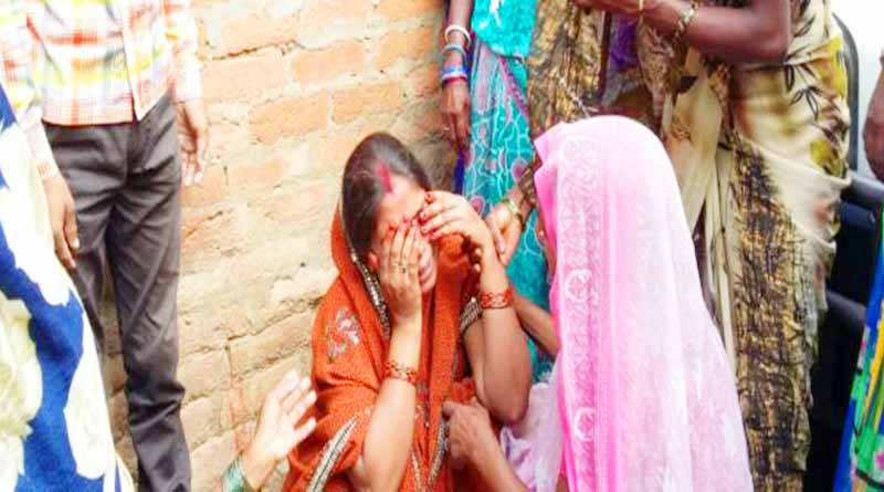 wife weeping for husband death