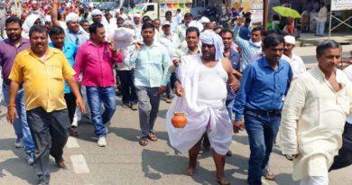 shikshamitra protest with statue